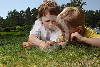 Boys with magnifying glass