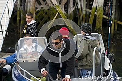 Boys off fishing in motorboat