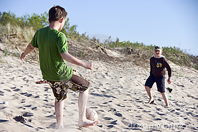 boys play Beach football