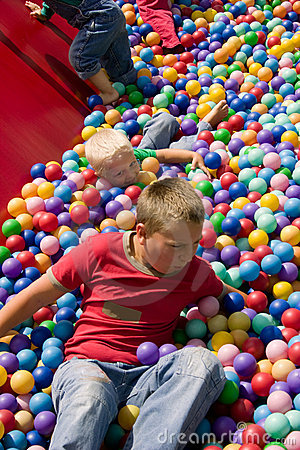 Boys playing in colourful ball pool