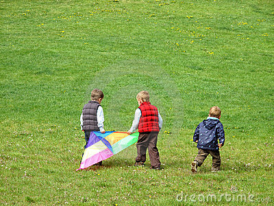 Boys playing with kite