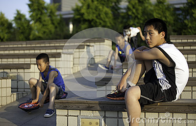 Boys playing at a park Editorial Stock Photo