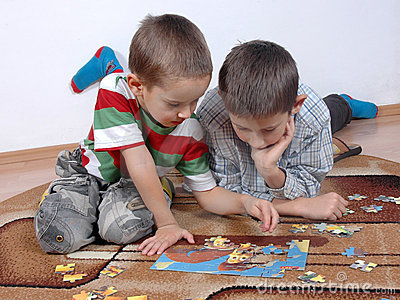 Boys playing the puzzle