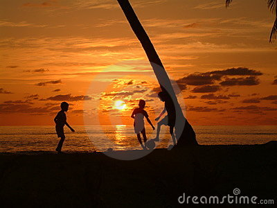 Boys Playing at sunset