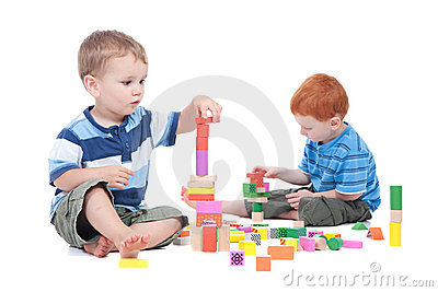 Boys playing with toy blocks