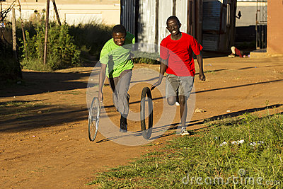 Boys Playing with Wheel