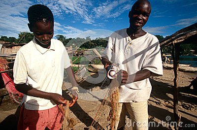 Boys preparing a fishing net, Uganda Editorial Photography