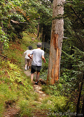 Boys running in trail