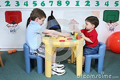 Boys Sharing Colorful Doah at Preschool