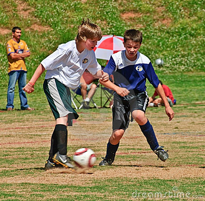 Boys Soccer Fight For the Ball Editorial Stock Image