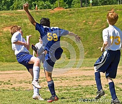Boys Soccer Kicking the Ball