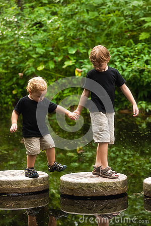 Boys on stepping stones