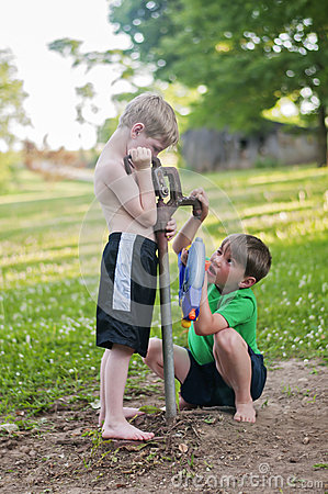 Free Boys Try Filling A Water Gun From Dry Stock Image - 94104841