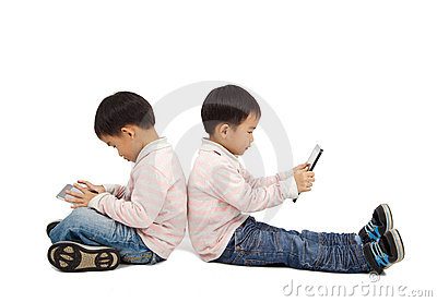 Boys using touchscreen tablet PC