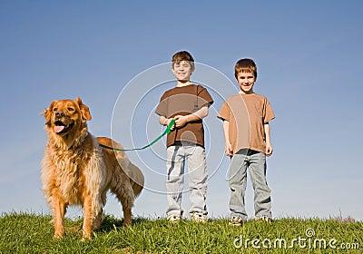 Boys Walking the dog