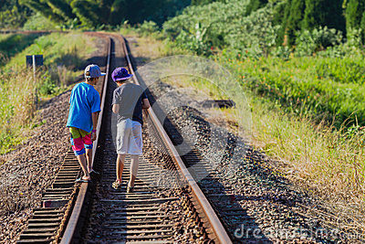 Boys Walking Railway Tracks Editorial Image