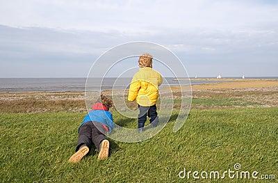 Boys watching sailing ships