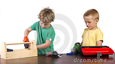 Boys working with their tools