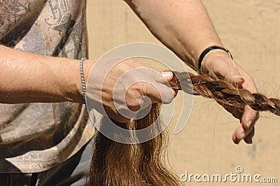 Braiding a horses tail