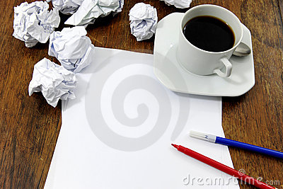 Brainstorming:  paper on desk with paperballs