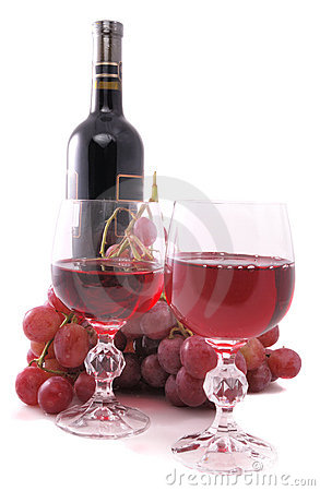 Branch of grapes, bottle of wine and glass