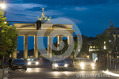 Brandenburg Gate lit with cars night