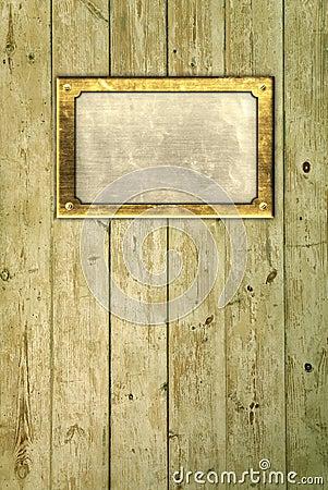 Brass frame on floorboards
