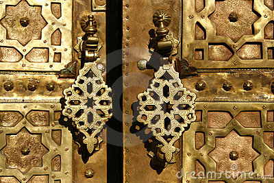 Brass gate with doorknockers. Marrakech, Morocco