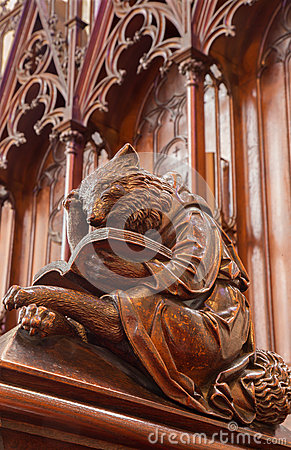 Bratislava - Bear at reading symbolic carved sculpture from bench in st. Matins cathedral