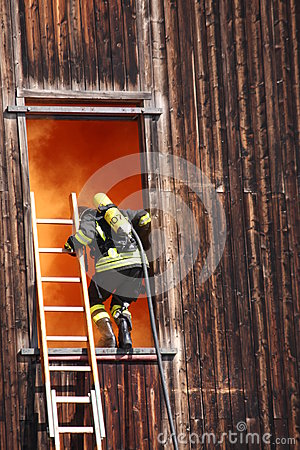 Free Brave Firefighters With Oxygen Cylinder Goes Into A House Throug Stock Photo - 30900690