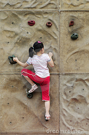 Brave Girl climbing on the wall