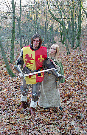 Brave knight and maid in forest