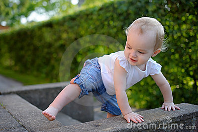 Brave little girl learning to climb