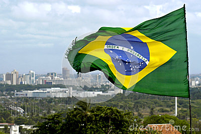 Brazilian flag and skyline city Recife, Brazil