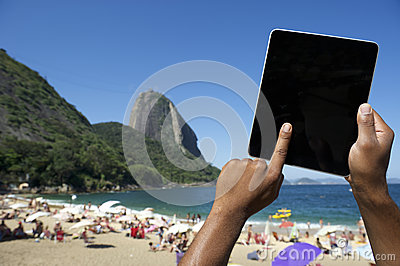 Brazilian Hands Using Tablet at Sugarloaf Rio de Janeiro Brazil