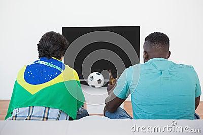 Brazilian soccer fans watching tv