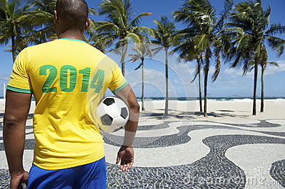 Brazilian soccer football player wears 2014 shirt Rio
