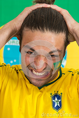 Brazilian sports fan in dispair