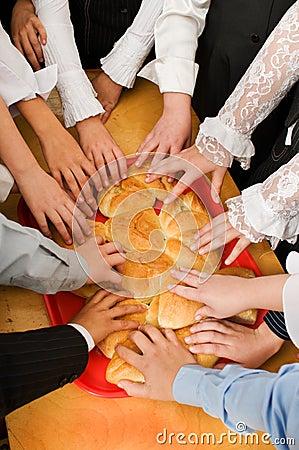 Bread and children s hands.