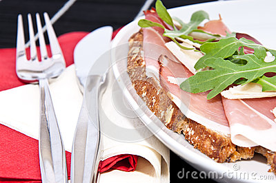 Bread with gammon on a plate