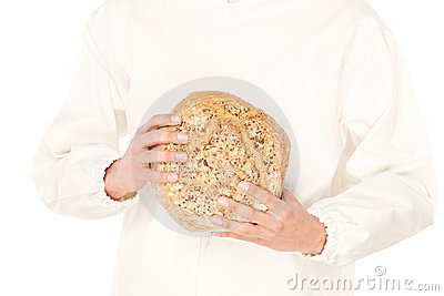 Bread in a hands of a baker