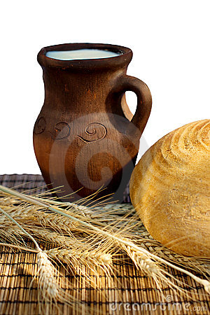 Bread and jug with milk
