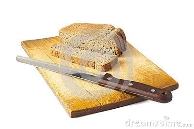 Bread with a knife on a wooden cutting board