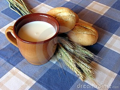 Bread, milk and wheat still-life