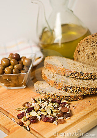 Bread, olives, seed and olive oil.