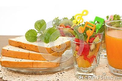 Bread slice and fruit salad with orange juice fusion food