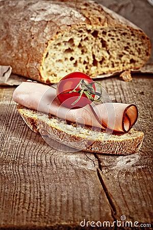 Bread with sliced pork ham close up
