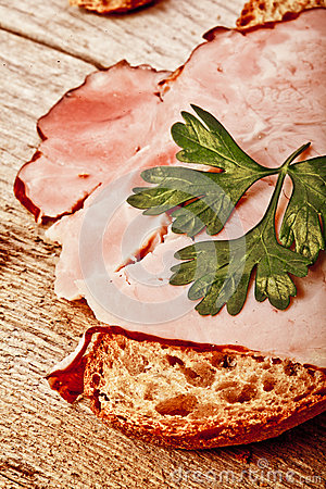 Bread with sliced pork ham close up