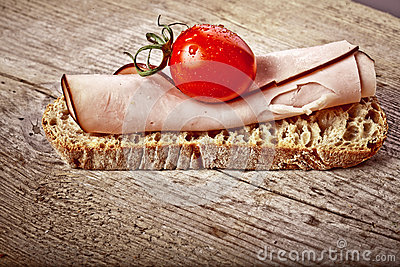 Bread with sliced pork ham