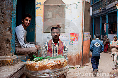 Bread trader sells bread on the narrow streets Editorial Stock Image